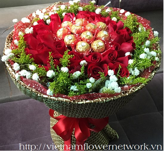 Bouquet of red roses and chocolate